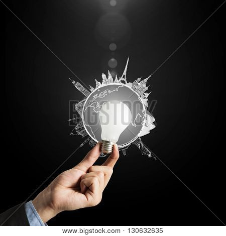 Glowing bulb in hand