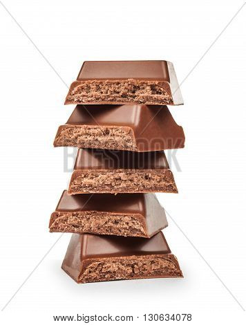 stack of chocolate pieces isolated on white background