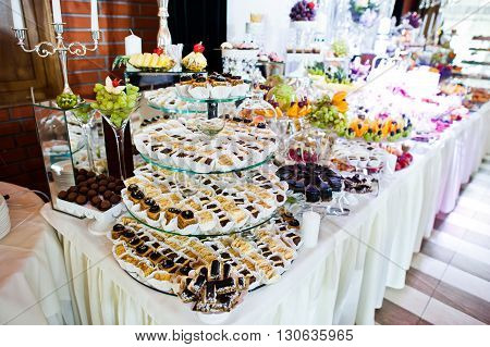 Elegance Wedding Reception Table With Food And Decor.
