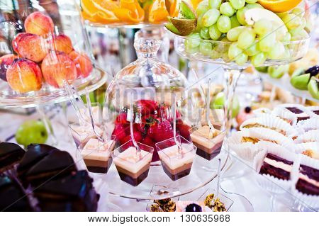 Elegance Wedding Reception Table With Food And Decor. Strawberry Under The Dome