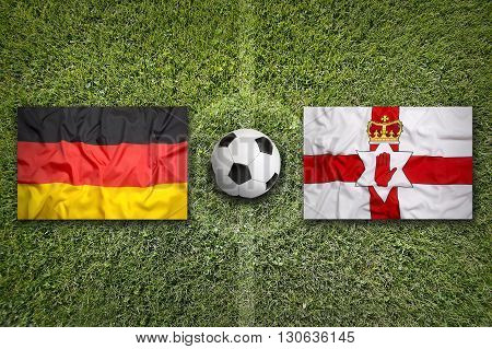 Germany Vs. Northern Ireland Flags On Soccer Field