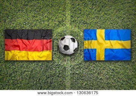 Germany Vs. Sweden Flags On Soccer Field