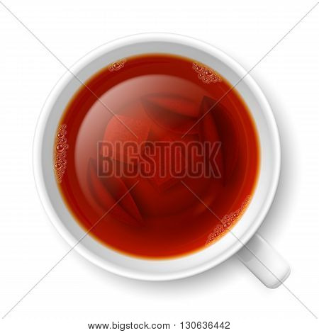 Cup of black tea with lumps of yellow cane sugar and tea leaves on the bottom over white background