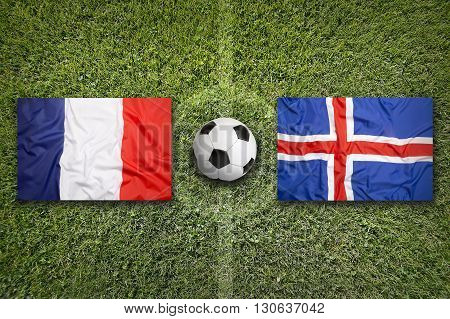 France Vs. Iceland Flags On Soccer Field