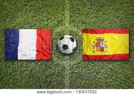 France Vs. Spain Flags On Soccer Field