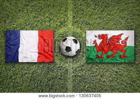 France Vs. Wales Flags On Soccer Field