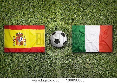 Spain Vs. Italy Flags On Soccer Field