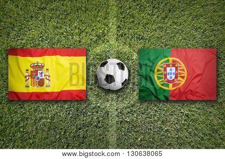 Spain Vs. Portugal Flags On Soccer Field