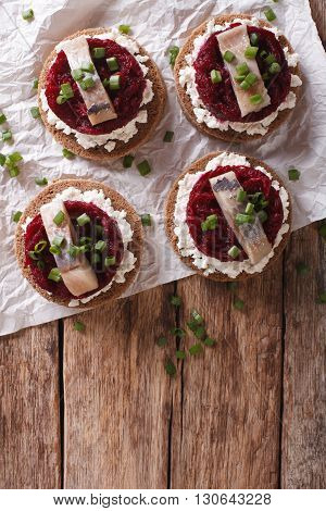 Scandinavian Sandwich With Herring, Beetroot And Cream Cheese. Vertical Top View