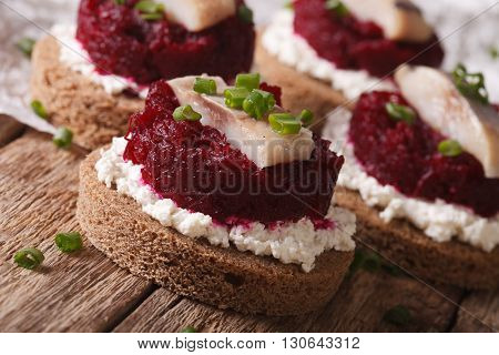 Fast Sandwiches With Herring, Beetroot And Cream Cheese Close-up. Horizontal