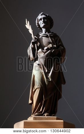 OBERSTAUFEN, GERMANY - OCTOBER 20: Saint Stephen statue on altar in the parish church of St. Peter and Paul in Oberstaufen, Germany on October 20, 2014