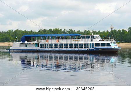 KIEV,UKRAINE - MAY 15, 2016: Pleasure boats on the Dnepr River and river shore in historical area. Kiev. Ukraine