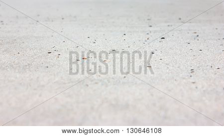 Background of white quartz sand closeup out of focus.