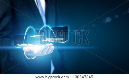 Businessman holding digital image of computer network