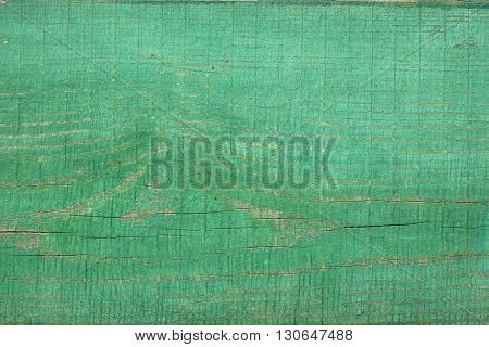 Green wooden board unevenly painted. Grenn background