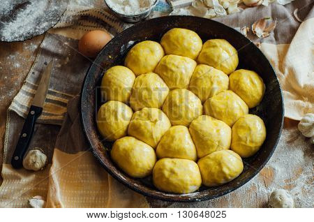 Preparing buns bread. Rustic style. Ingredients for homemade bread on wooden background. Bread cooking process. kneading dough on wooden platebun cooking