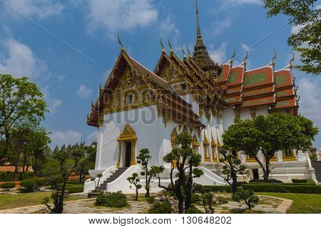 Shot of a Buddhist Pagoda in Thailand with blue skies in the background