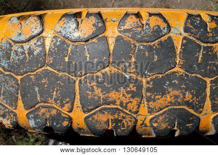 Old truck tire texture. Grunge stile background.