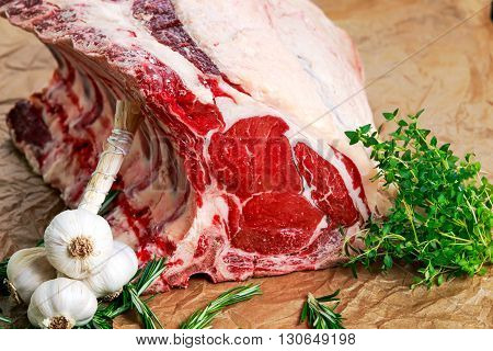 Fresh Raw Beef bone rib roughly choppid. with herbs and seasoning