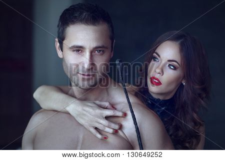 Sexy dominatrix grip young macho lover bdsm sensual couple foreplay at night
