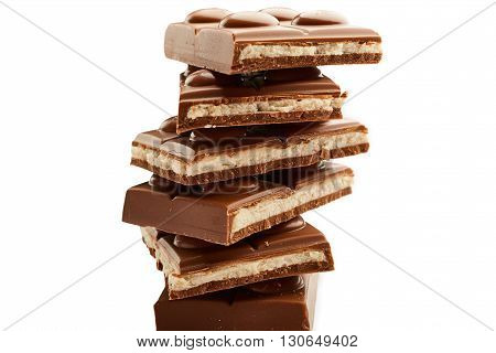 stack of chocolate snacks isolated over white seamless background