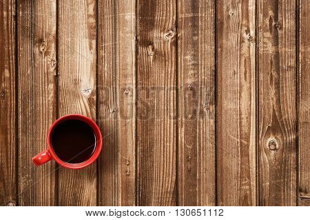 Red coffee cup top view on table