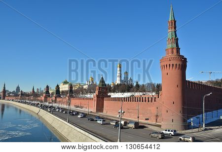 Kremlin embankment in Moscow. The walls of the Kremlin and churches from the side of the Moscow river.