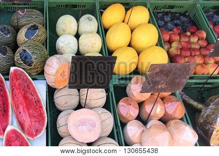 Organic fresh summer fruits on market stall