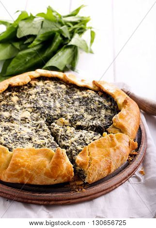 Spinach and feta galette on board on table