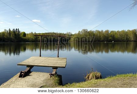 A very littel jetty at the shore of a river in the North of Sweden.