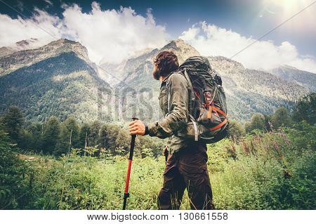 Man explorer with backpack hiking Travel Lifestyle concept beautiful mountains landscape on background adventure vacations outdoor