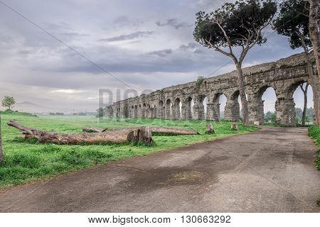 Italy, Rome, Acquedotto Claudio - The impressive ruins of the ancient Roman aqueduct