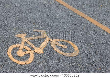 Bicycle Lane Signage On Street. Yellow Bicycle Sign On Asphalt Bike Lane.