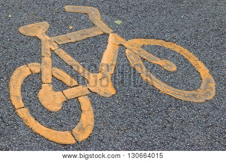 Bicycle Lane Signage On Street. Yellow Bicycle Sign On Asphalt Bike Lane.