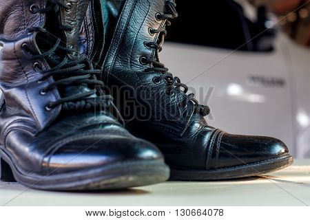 Closed up Black military leather boots for background
