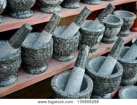 Angsila's stone mortar and pestle, in Thailand