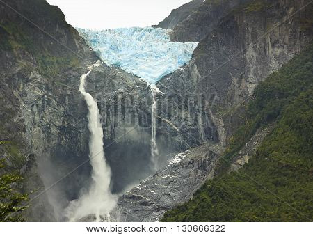 scenic view on glacier ventisquero calgante with waterfall in chilean patagonia on the road Carretera austral