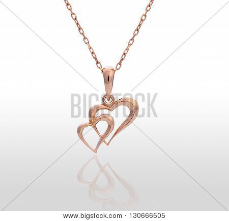 heart pendant of gold, diamond chain. Isolated white background.