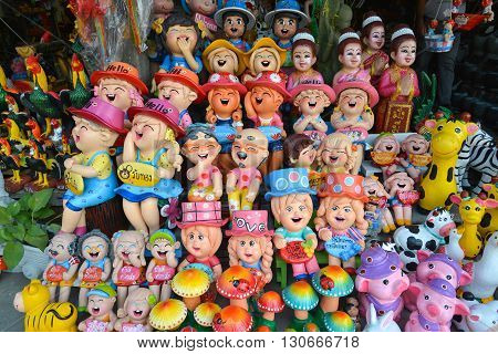 Angsila Thailand - April 4 2016 : Colorful Clay doll Shop in Angsila city