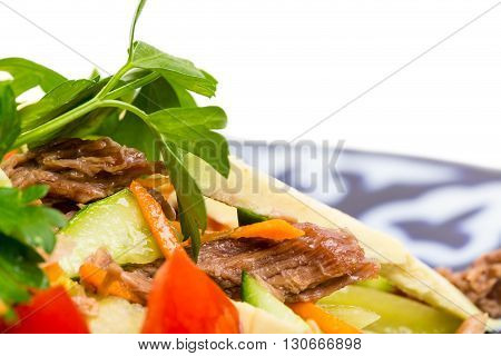 Delicious veal salad with cucumbers and avocado. Macro. Photo can be used as a whole background.