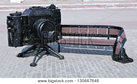 KRASNOGORSK, RUSSIA - APRIL 30, 2016: Bench in the shape of the retro camera. The inscription in Russian