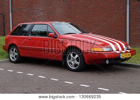 Almere, The Netherlands - May 21, 2016: Red Volvo 480 sports coupe parked in a public parking lot. Nobody in de vehicle.