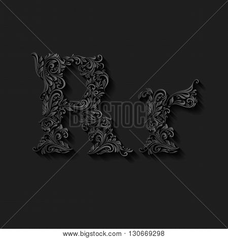 Handsomely decorated letter r in upper and lower case on black