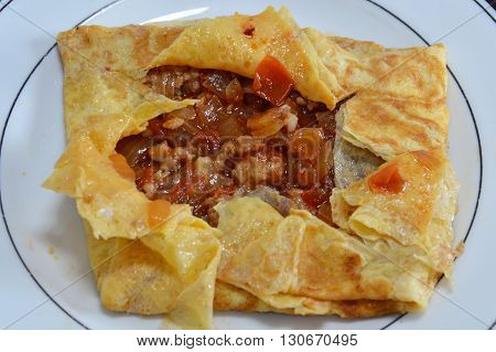 minced pork stuffed omelets on the dish