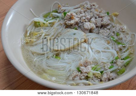 rice vermicelli topping fish line and boiled minced pork in soup