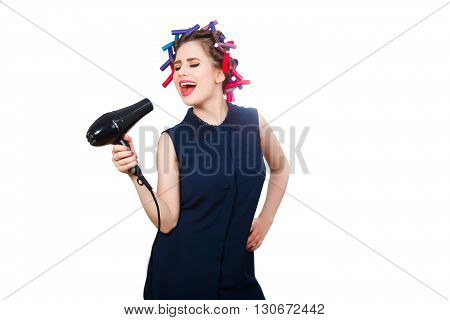 Young woman in curler expressively singing. Isolated