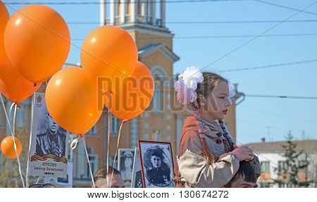 Irkutsk, Russia - May 9, 2015: Young Girl On Fathers Shoulders And  Orange Balloons On Victory Day I