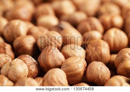 peeled hazelnuts close up background, food backdrop