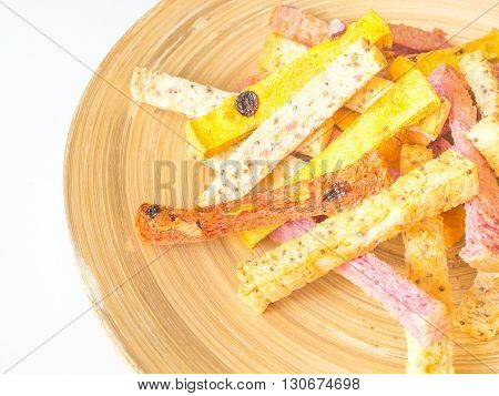 Organic and low fat crispy breads on wooden plate for breakfast