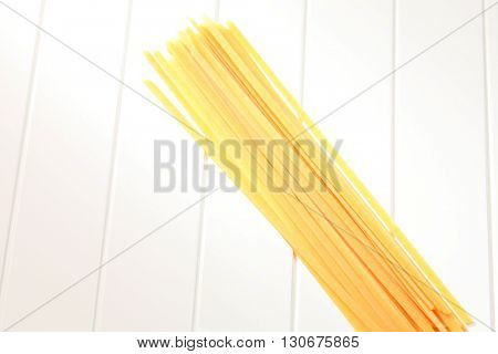 pasta linguine on the white wooden table
